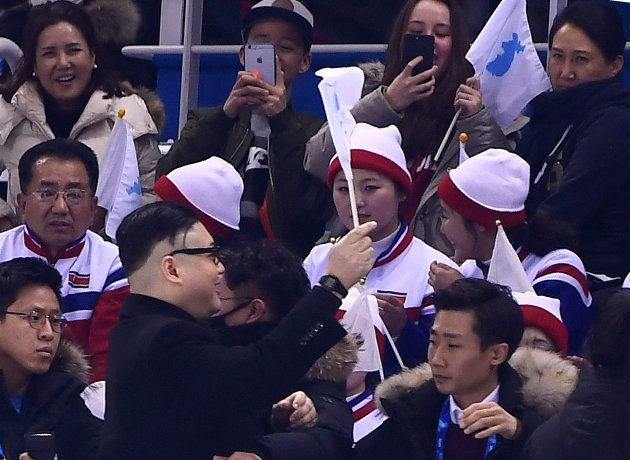 A Kim Jong Un impersonator cheers in front of North Korean cheerleaders during the final period of the...