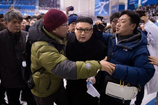 TOPSHOT - A Kim Jong Un impersonator is forced out in the final period of the women's preliminary round...