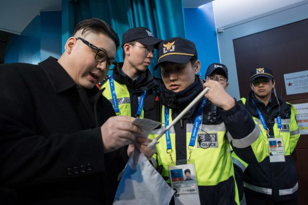 South Korean police check the ticket of a man impersonating North Korean leader Kim Jong Un after he...