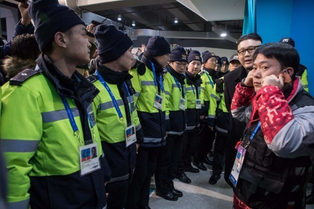 South Korean police surround a man impersonating North Korean leader Kim Jong Un after he appeared before...