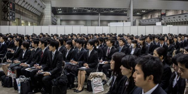 TOKYO, JAPAN - MARCH 08: (EDITORIAL USE ONLY) College students listen to a company information session...