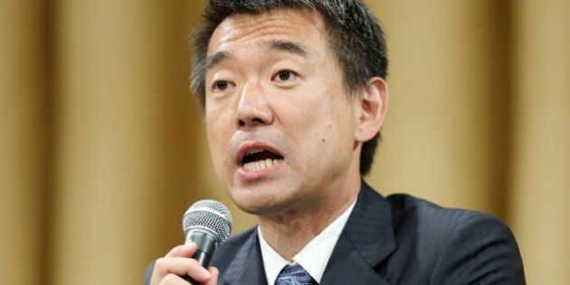 Japanese Osaka Mayor Toru Hashimoto speaks to media as a referendum to reform the city administration...
