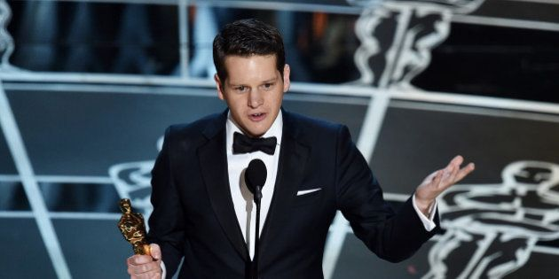 HOLLYWOOD, CA - FEBRUARY 22: Screenwriter Graham Moore accepts the Best Adapted Screenplay Award for...
