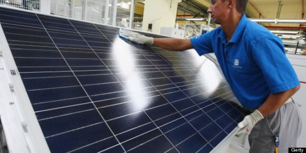 FRANKFURT (ODER), GERMANY - AUGUST 19: A worker cleans a finished solar energy panel at a production...
