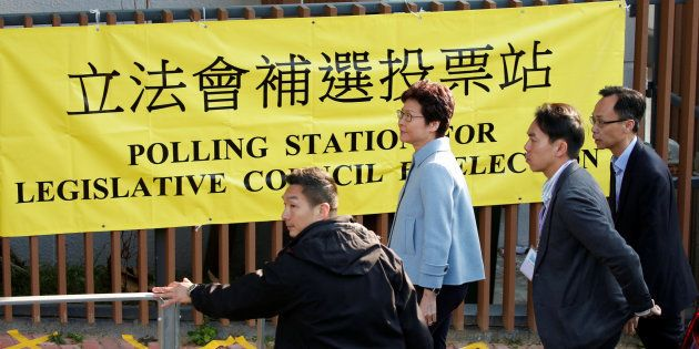 Hong Kong Chief Executive Carrie Lam arrives at a polling station to vote during a Legislative Council...