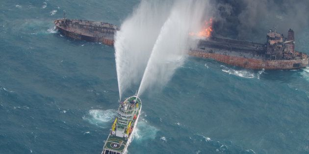 A rescue ship works to extinguish the fire on the stricken Iranian oil tanker Sanchi in the East China...