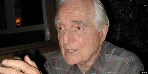 American computer pioneer and inventor Douglas Engelbart sits in conversation at a table, Palo Alto,...