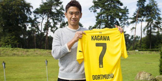 DORTMUND, GERMANY - AUGUST 31: Shinji Kagawa of Dortmund signs his new Borussia Dortmund contract at...