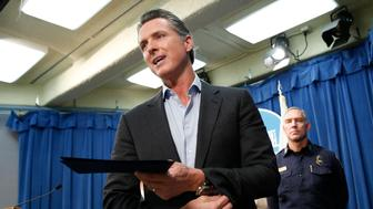 California Gov. Gavin Newsom answers a reporter's question as he leaves a news conference where he signed an executive order to withdraw most of the National Guard troops from the nation's southern border and changing their mission, during a Capitol news conference Monday, Feb. 11, 2019, in Sacramento, Calif. (AP Photo/Rich Pedroncelli)