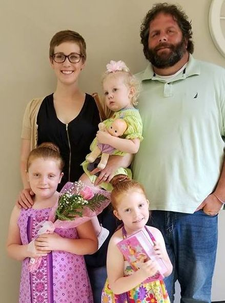 Dina Zirlott in 2018 with her husband, Lance, and their daughters, Aine (7), Ariadne (5) and Asher (3).