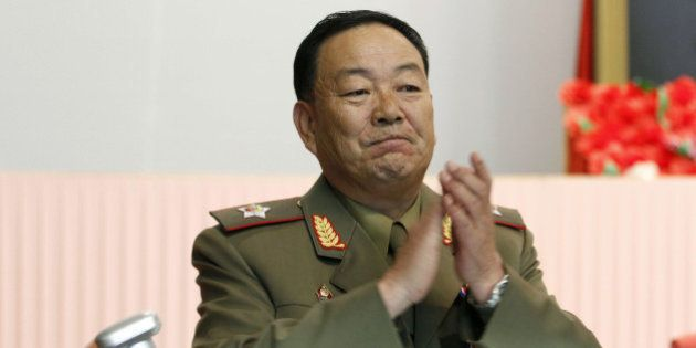 Vice Marshal Hyon Yong Chol applauds during a meeting at the April 25 House of Culture announcing North...