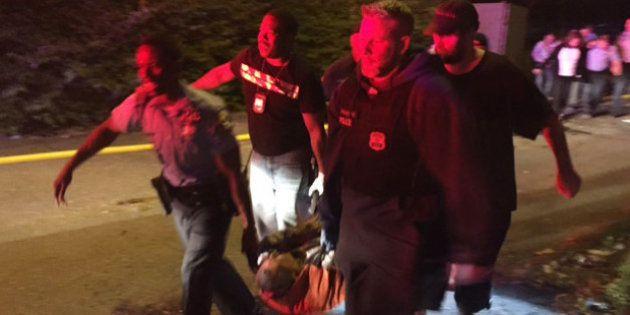 A passenger is carried following an Amtrak train crash Tuesday, May 12, 2015, near Philadelphia. Train...