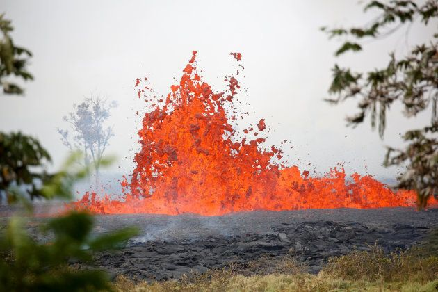 Lava erupts on the outskirts of Pahoa during ongoing eruptions of the Kilauea Volcano in Hawaii, U.S.,...