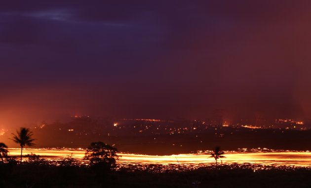 KAPOHO, HI - MAY 19: A lava flow from a Kilauea volcano fissure is blurred as it advances in a long exposure...