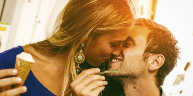 Young couple in love while eating an