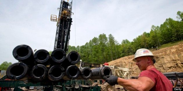 Brian Lairson prepares drill pipe as a shale-gas well is drilled in Mannington, West Virginia, U.S.,...