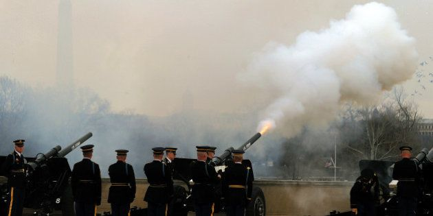 US military honor guard fire canons to gun-salute Chine Vice President Xi Jinping during a honor guard...