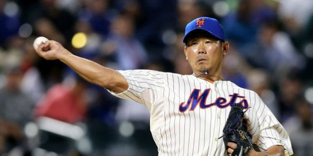 NEW YORK, NY - MAY 20: Daisuke Matsuzaka #16 of the New York Mets sends the ball to first in an attempt...
