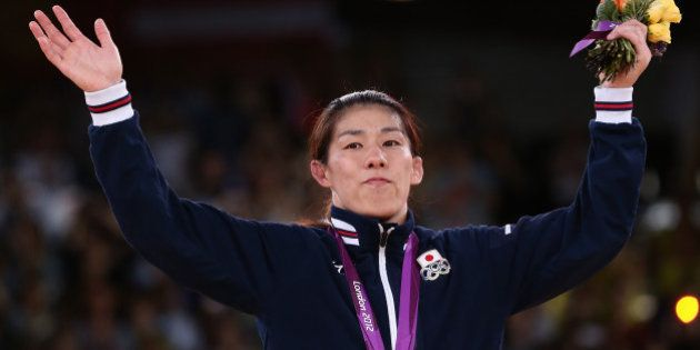 LONDON, ENGLAND - AUGUST 09: Saori Yoshida of Japan celebrates winning the gold medal in the Women's...