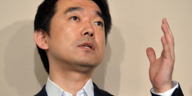 Osaka mayor and co-leader of the Japan Restoration Party Toru Hashimoto speaks before press at the Osaka...