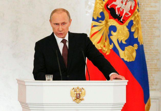 クリミアをロシアに編入する方針を宣言するプーチン大統領=2014年3月、モスクワ・クレムリン