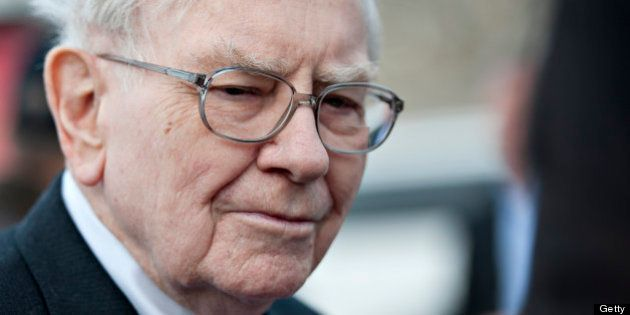 Warren Buffett, chairman and chief executive officer of Berkshire Hathaway Inc., listens while speaking...