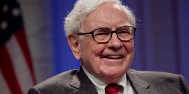 Warren Buffett, chairman of Berkshire Hathaway Inc., laughs during an interview at the Economic Club...