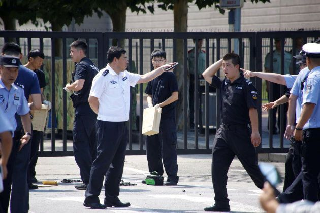Police officers are seen near the U.S. embassy in Beijing, China July 26, 2018. REUTERS/Thomas