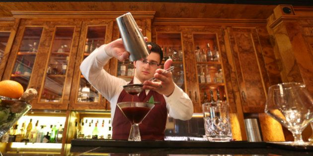 A barman prepares a vodka cocktail in a bar at the luxury Four Seasons Hotel Lion Palace, operated by...