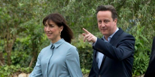 Britain's Prime Minister and Conservative Party leader David Cameron and his wife Samantha arrive to...