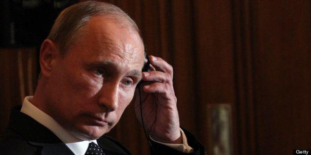 LONDON, UNITED KINGDOM - JUNE 16: Russian President Vladimir Putin (R) attends a joint press conference...