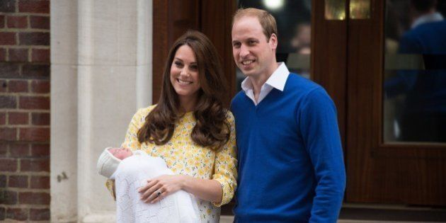 Britain's Prince William (R) and Catherine, Duchess of Cambridge show their newly-born daughter, their...
