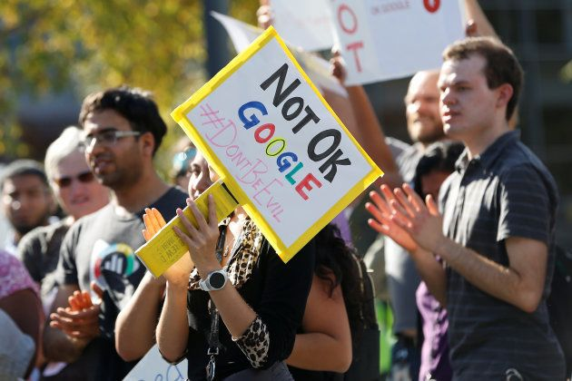 A Google employee holds a sign during a