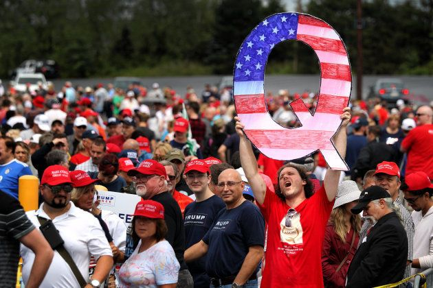 WILKES BARRE, PA - AUGUST 02: David Reinert holds up a large 'Q' sign while waiting in line to see President...