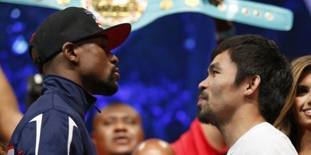 Floyd Mayweather Jr., left, and Manny Pacquiao pose during their weigh-in on Friday, May 1, 2015 in Las...