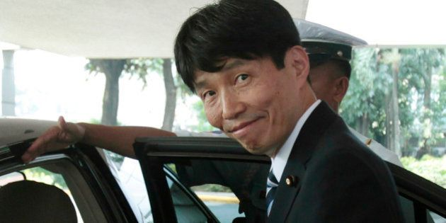 Japanese Minister of State for Okinawa and Northern Territories Ichita Yamamoto smiles after meeting...