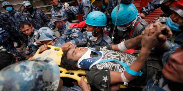 Pemba Tamang is carried on a stretcher after being rescued by Nepalese policemen and U.S. rescue workers...