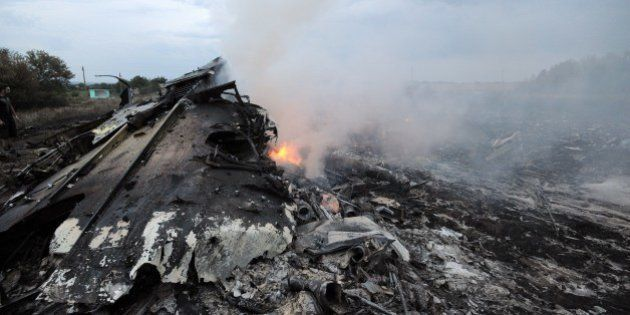 A picture taken on July 17, 2014 shows wreckages of the malaysian airliner carrying 295 people from Amsterdam...