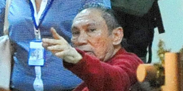 Former Panamenian dictator Manuel Noriega gestures upon arrival at the Renacer prison, 25 km south east...