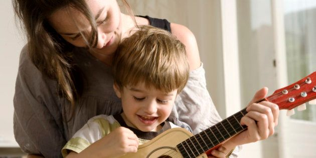 Young Mother Showing her Son how to Play