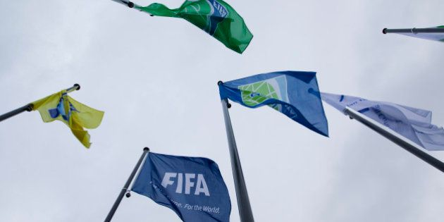 Flags of the World Soccer Association FIFA are seen in front of it's headquarter in Zurich, on October...