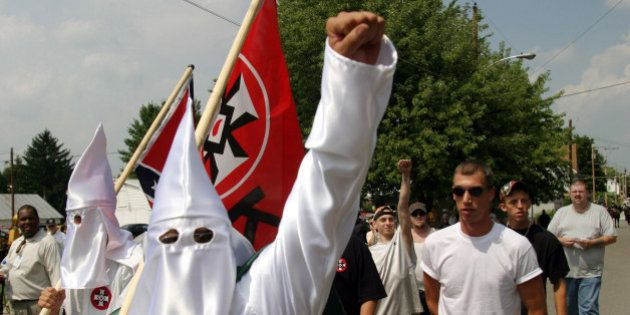 Members of the World Knights of the Ku Klux Klan as they march along a street, Saturday, Aug. 28, 2004,...