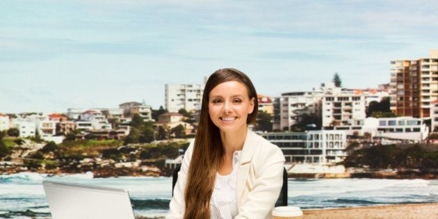 Smiling businesswoman sitting and working outdoorshttp://www.twodozendesign.info/i/1.png