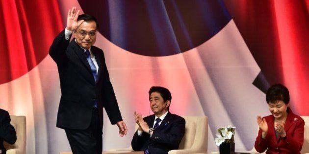 Chinese Premier Li Keqiang (2nd L) waves after his speech as South Korean President Park Geun-Hye (R)...