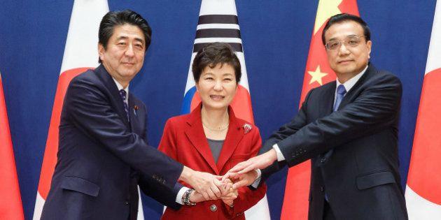SEOUL, SOUTH KOREA - NOVEMBER 01: South Korean President Park Geun-Hye (C) poses with Japanese Prime...