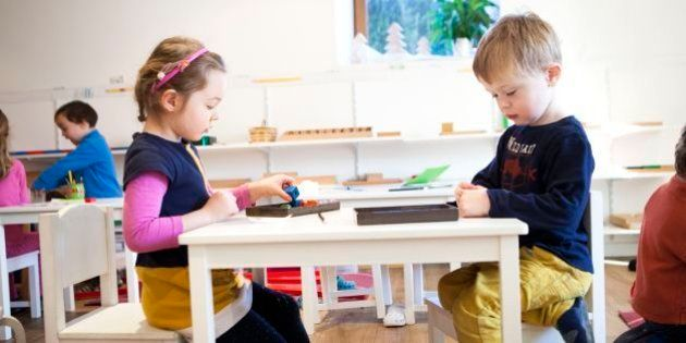 Bilingual Montessori school in Haute-Savoie, France, which caters to children 2 to 6 years old. kids are all in the same class to encourage socialisation, the older ones look after the younger ones, which boosts self-confidence in the older ones and increases motivation to work in the younger ones. Montessori education psychology used in the school aims to develop the autonomy, desire and curiosity of the child. In this exercise, the child must write a number on a piece of paper and give it to their classmate. The classmate must bring the same number of one object as they read on the piece of paper. (Photo by: BSIP/UIG via Getty Images)