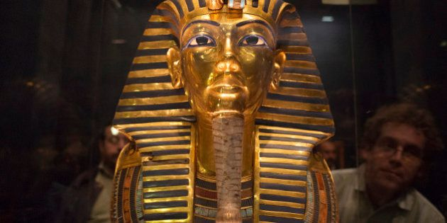 The mask of King Tutankhamun, which was found to have been damaged and glued back together, is seen at...