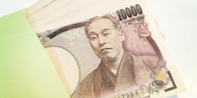 Japanese currency sticking out of envelope. Taken on July 3, 2013 with a mobile