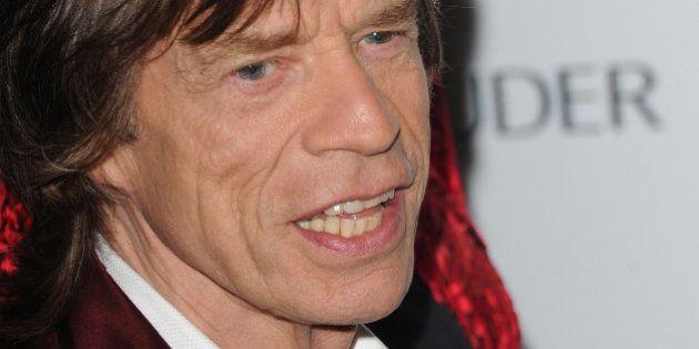 LONDON, ENGLAND - NOVEMBER 05: Mick Jagger and L'Wren Scott arrive for the Harpers Bazaar Women Of The...