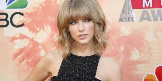 Singer Taylor Swift poses at the 2015 iHeartRadio Music Awards in Los Angeles, California, March 29,...